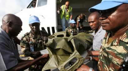 The bodies of the United Nations peacekeepers killed on June 8, 2012 in western Ivory coast near the Liberia border arrive at the Felix Houphouet-Boigny International Airport, near Abidjan June 9, 2012 (Reuters/Luc Gnago)