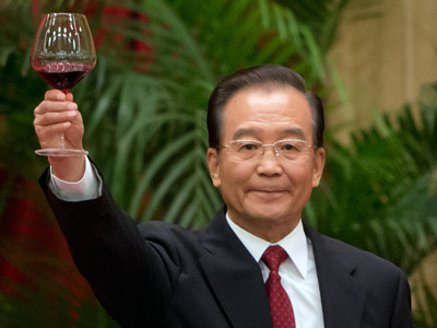 China's Premier Wen Jiabao raises his glass as he makes a toast during the 63rd National Day reception at the Great Hall of the People on September 29, 2012. (AFP Photo/Ed Jones)