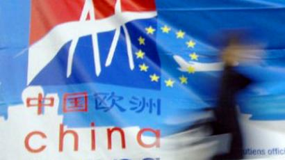 A person walks by the banner of the 2nd China Europa business convention (AFP Photo / Mychele Daniau)