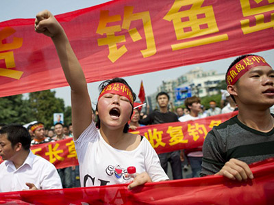 "A Chinese demonstrator shouts slogans during a protest against Japan's ""nationalizing"" of Diaoyu Islands, also known as Senkaku in Japan, in Hangzhou, east China's Zhejiang province, on Septermber 18, 2012. (AFP Photo)"
