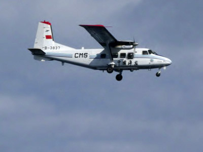 An airplane belonging to China's state oceanic administration  15 km south of the disputed islets, known as Senkaku in Japan and Diaoyu in China. December 13, 2012. (Reuters/11th Regional Coast Guard Headquarters-Japan Coast Guard)