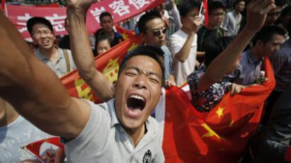 Demonstrators shout slogans as they march with Chinese national flags and banners near the Japanese consulate during a protest on the 81st anniversary of Japan's invasion of China, in Shanghai September 18, 2012. (Reuters/Carlos Barria)