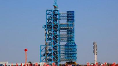 "The Tiangong-1, or ""Heavenly Palace"" module sits atop a Long March 2F rocket prior to takeoff at the Jiuquan launch centre in Gansu province on September 28, 2011. (China Out / AFP Photo)"