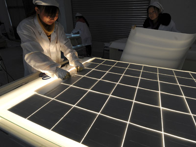 Employees work on a solar panel production line at a solar company workshop in Hefei, Anhui province, China (Reuters/Jianan Yu)