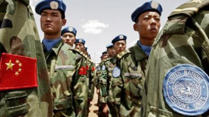 Peacekeepers or colonialists? China's UN contingent in Darfour (AFP Photo/HO/Stuart Price/Aalbany Assosiates)