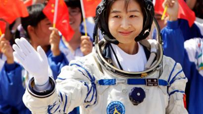 Liu Yang, China's first female astronaut, waves during a departure ceremony at Jiuquan Satellite Launch Center, Gansu province (Reuters / Jason Lee)