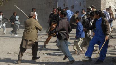 Afghan protesters shout anti-US slogans during a protest in Jalalabad province February 25, 2012  (Reuters / Parwiz Parwiz)