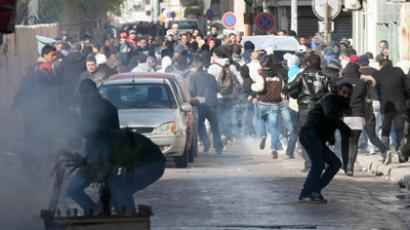 Tunisian protestors clash with security forces outside the Interior Ministry in Tunis, on February 7, 2013 following a demonstration against the killing of opposition figure and human rights lawyer Chokri Belaid (AFP Photo / Khalil)
