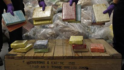 Cocaine from Britain's largest ever cocaine seizure is displayed by UK Border Agency staff in London August 3, 2011.(Reuters/Stefan Wermuth)