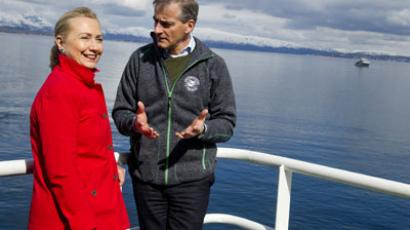 US Secretary of State Hillary Clinton and Norway's Minister of Foreign Affairs Jonas Gahr Stoere (R), talk onboard the Arctic Research Vessel Helmer Hanssen during a boat tour of a fjord off of Tromsø, Norway, in the Arctic Circle, June 2, 2012. (AFP Photo / Saul Loeb)