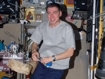 Sergey Volkov tests new underwear on board the ISS. Image from roscosmos.ru