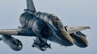 "Mirage 2000 jet of the French army flying back after taking part in military operations in Libya. NATO looks set to agree today to take command of military operations against Moamer Kadhafi as France fights to keep political control in the hands of the US-led ""coalition of the willing"". (AFP Photo / Nicolas Nelson Richard)"