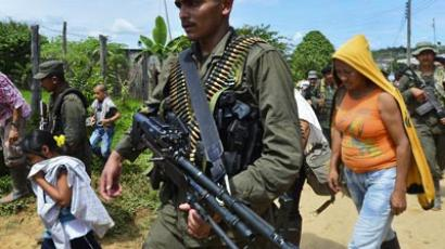 A heavily armed FARC guerrilla (AFP Photo/Luis Acosta)