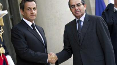 French President Nicolas Sarkozy (L) welcomes the Prime Minister of Libya's revolutionary National Transitional Council, Mahmud Jibril (AFP Photo / Lionel Bonaventure)