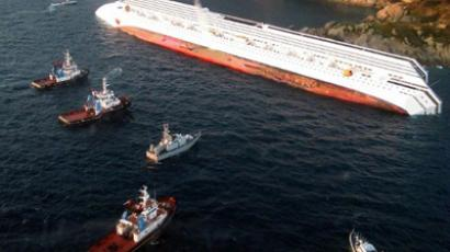 A handout aerial view taken and released on January 14, 2012 by Italian Guardia de Finanza shows the Costa Concordia, after the cruise ship ran aground and keeled over off the Isola del Giglio, on late January 13 (AFP Photo / ITALIAN GUARDIA DE FINANZA)