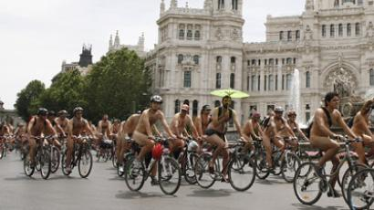 Cyclists ride nude through central Madrid during the ciclonudista (nude cyclist) protest against the dangers commuter cyclists face in Madrid, in conjunction with the World Naked Bike Ride June 9, 2012. (Reuters/Paul Hanna)