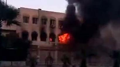 An image grab taken from a video uploaded on YouTube on July 18, 2012 shows smoke billowing from a municipality building in the Al-Hajar al-Aswad district of the Syrian capital Damascus during clashes between Syrian forces and armed rebels (AFP Photo/YouTube)