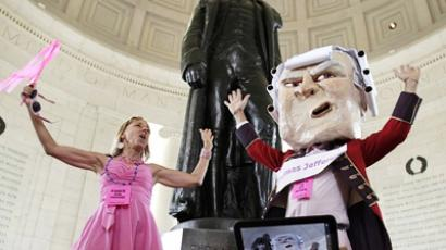 Code Pink activists, including a puppet representation of Thomas Jefferson, dance inside the Jefferson Memorial in Washington June 4, 2011 (AFP Photo / Getty Images)