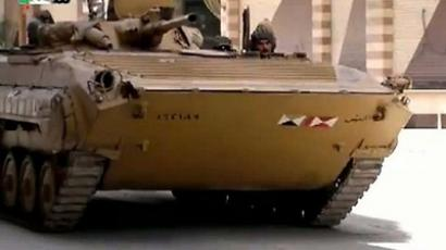 An image grab taken from a video uploaded on YouTube on April 9, 2012 shows Syrian troops deploying in Saqba on the outskirts of Damascus (AFP Photo/Youtube)
