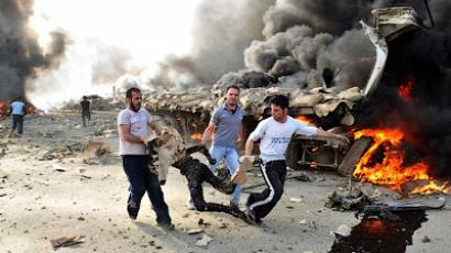 A handout picture from the Syrian Arab News Agency (SANA) shows Syrian men carrying away a corpse at the site of twin blasts in Damascus on May 10, 2012 (AFP Photo/HO/SANA)