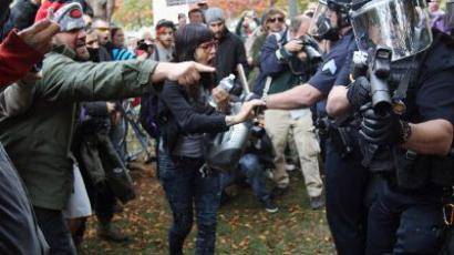 "Policemen in riot gear face off with demonstrators at the ""Occupy Denver"" camp on October 29, 2011 in Denver, Colorado (John Moore/Getty Images/AFP) Video from Youtube, uploaded by user grigsbyguy"