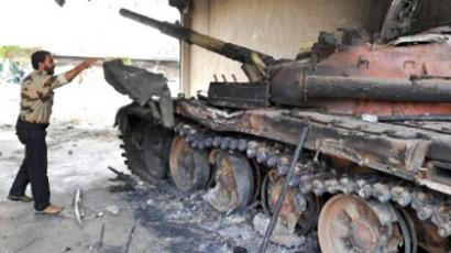 A tank for Moamer Kadhafi's forces that was destroyed by a NATO bombing, AFP Photo / Christophe Simon