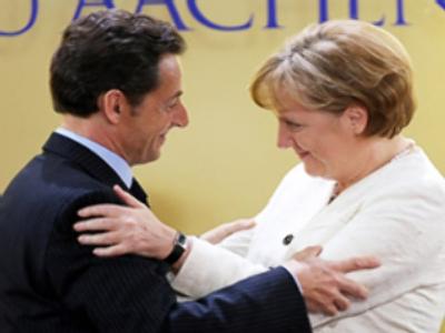 Angela Merkel (R) and French President Nicolas Sarcozy (AFP Photo / Juergen Schwarz)