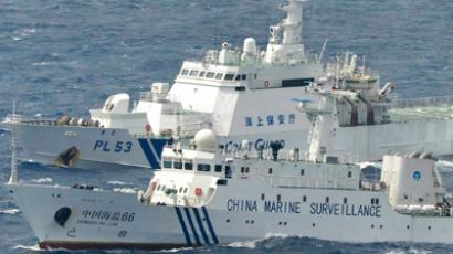 Chinese marine surveillance ship Haijian No. 66 (front) cruising next to a Japan Coast Guard patrol ship in the East China Sea, known as Senkaku isles in Japan and Diaoyu islands in China (Reuters / Kyodo)