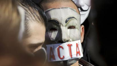 Protesters wearing Anonymous Guy Fawkes masks take part in a demonstration against controversial Anti-Counterfeiting Trade Agreement (ACTA) (AFP Photo/Jean-Philippe Ksiazek)