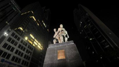A statue of late Philippine senator Benigno Aquino (C), father of current Philippine President Benigno Aquino, stands illuminated as street lights are turned off to mark Earth Hour in Makati, the financial district of Manila on March 31, 2012 (AFP Photo/Noel Celis)