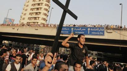 Angry Egyptian Christians protest outside St. Mark's Cathedral against the military ruling council, in Cairo on October 10, 2011 (AFP Photo / Mahmud Hams)