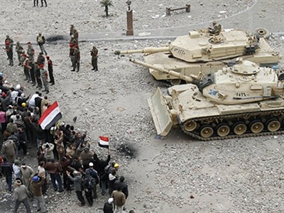 Egyptian anti-government demonstrators face army tanks in Cairo's Tahrir square on February 05, 2011 (AFP Photo / Mohammed Abed)