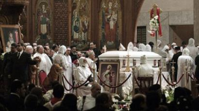 The casket containing the body of Pope Shenuda III, the spiritual leader of the Middle East's largest Christian minority, is seen in Saint Mark's Coptic Cathedral in Cairo's al-Abbassiya district on March 20, 2012 during prayers ahead of his funeral. Egypt's Coptic Christians were preparing to bury Pope Shenuda III, who died at the weekend at the age of 88, leaving behind his flock of decades full of anxiety over rising Islamism. (AFP Photo / GIANLUIGI GUERCIA)