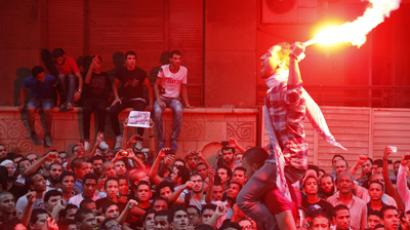 People shout slogans and light flares in front of the U.S. embassy during a protest against what they said was a film being produced in the United States that was insulting to the Prophet Mohammad, in Cairo September 11, 2012 (Reuters / Amr Abdallah Dalsh)