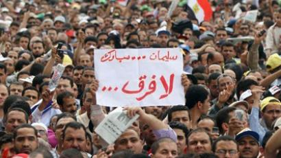 "Holding up a sign that reads in Arabic, ""There is no difference between former president Hosni Mubarak and Omar Suleiman, Mubarak's former intelligence chief, thousands of Islamists demonstrate in the capital's landmark Tahrir Square (AFP Photo / Khaled Desouki)"