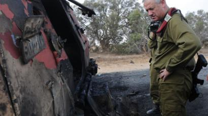 Burnt vehicle near the Kerem Shalom border crossing after unidentified gunmen crossed into Israel from Egypt on August 6, 2012 (AFP Photo / IDF / Gal Ashuach)