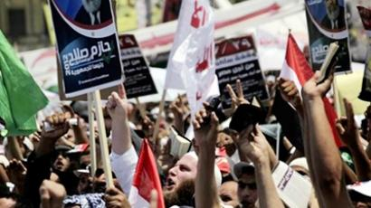 An Egyptian shouts slogans during a protest of Islamist groups at Tahrir Square, the focal point of Egyptian uprising, in Cairo, Egypt, Friday, July 29, 2011 (photo from daylife.com)