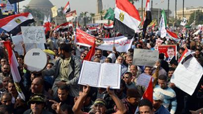 Thousands of Islamists stage a rally in front of Cairo's University on December 1, 2012, in support of Egypt's President Mohamed Morsi's new expanded powers and the drafting of a contested charter, in a clear show of Egypt's widening polarisation. (AFP Photo / Khaled Desouki)