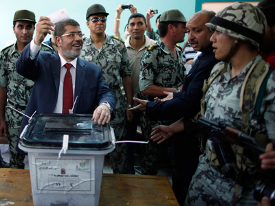 Presidential candidate Mohamed Morsi of the Muslim Brotherhood casts his vote at a polling station at a school in Al-Sharqya (Reuters / Ahmed Jadallah)