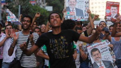Supporters of the Muslim Brotherhood's presidential candidate Morsy carry a poster for him as they celebrate his victory in the presidential elections in Cairo (Reuters / Asmaa Waguih)