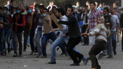 Egyptian protesters hurl stones towards Egyptian riot Police during clashes at Tahrir square on November 25, 2012 in Cairo. (AFP Photo)