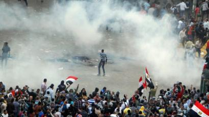 Protesters run from tear gas released by riot police during clashes at Tahrir square in Cairo November 23, 2012.(Reuters / Mohamed Abd El Ghany)