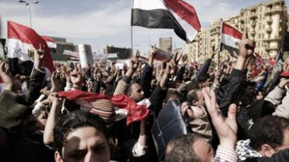 Cairo : Egyptian protesters wave national flags and shout slogans against the military rulers of the country. (AFP Photo/Gianluigi Guercia)