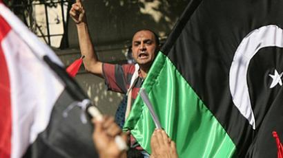 Egypt, Cairo: Protesters shout slogans against Libyan leader Moamer Kadhafi during a demonstration outside the Arab League headquarters in the Egyptian capital Cairo on February 22, 2011. (AFP Photo / Khaled Desouki)