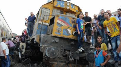 Egyptians gather around a train which is crashed and derailed near Badrashin station south of Cairo on its way to the town of Sohag on July 17, 2012 (AFP Photo/Str)