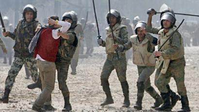 Egypt, Cairo : Egyptian soldiers beat-up a protester during clashes near Cairo's Tahrir Square on December 16, 2011 after demonstrators threw petrol bombs and set fire to furniture in front of the nearby parliament. (AFP Photo / Mohammed Abed)