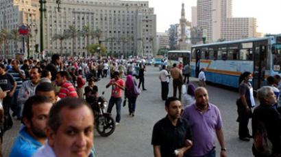 EGYPT, Cairo : Egyptians walk at Tahrir Square in Cairo on June 29, 2011 after bloody clashes between protesters and anti-riot police that raged overnight in the landmark square erupted in new scuffles amid mounting frustration with Egypt's military rulers over the pace of reform (AFP Photo / Khaled Desouki)