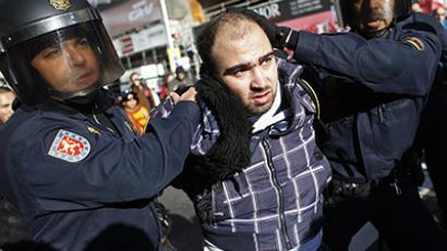 Police detain a man as picketers and protesters clashed with police during a 24-hour nationwide general strike in Madrid, November 14, 2012. (Reuters / Susana Vera)