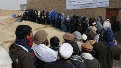 Afghans line up to receive winter supplies at a UNHCR distribution centre for needy refugees on the outskirts of Kabul (AFP Photo / Shah Marai)