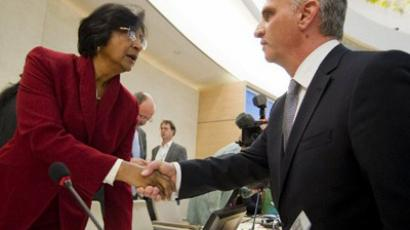 UN Commissioner for Human Rights Navi Pillay (L) shakes hands with Swiss foreign minister Didier Burkhalter at the opening of a session of the United Nation Human Rights Council on February 27, 2012 in Geneva. (AFP Photo / Fabrice Cofrrini)